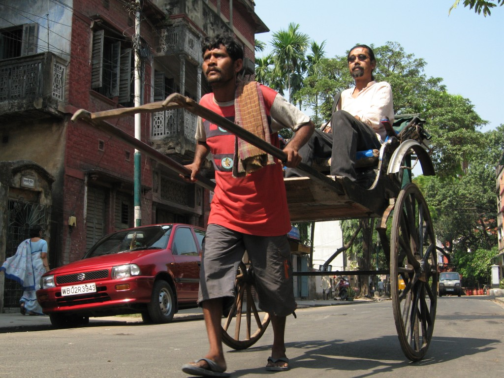 Manoj Singh pulls his rickshaw in Kolkata, India in this scene from 'Happy'
